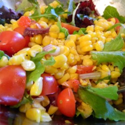 Roasted Corn and Heirloom Tomato Salad Recipe - A colorful salad contains grilled fresh corn and roasted bell peppers tossed with heirloom tomatoes and basil in a simple balsamic vinegar dressing.