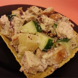 Hen's Nest Chicken Salad Recipe - A light and pretty chicken salad with pineapple chunks and walnuts is served in taco salad bowl 'nests' for a quick lunch idea.