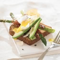 Spring Asparagus Ham and Egg Sandwich Recipe - Fresh garden-grown asparagus combined with two poached eggs, ham and toasted whole grain bread creates the perfect open-faced brunch sandwich!