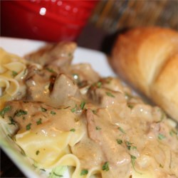 Easy Slow Cooker Stroganoff Recipe - Sirloin beef tips simmer for hours until tender with mushroom soup and fresh mushrooms for a simple yet savory dish to serve over wide egg noodles.