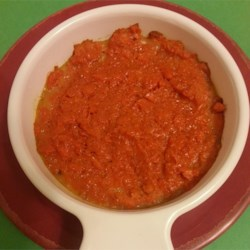 Jeff's Carrots Recipe - Bright orange mashed and baked carrots are sweetly flavored with vanilla extract, allspice, nutmeg, and ginger for a pretty side dish perfect for Easter dinner.