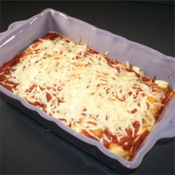 Christmas Eve Manicotti Recipe - Spinach and cheese-stuffed crepes baked with marinara sauce make a nice light alternative to heavy holiday fare or a delicious second main dish to enjoy during Christmas dinner. Give crepe batter an hour or more to rest for the tenderest texture.