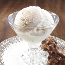 Salted Pecan-Maple Ice Cream Recipe - A hint of salt and sweet from homemade candied pecans gives maple-flavored ice cream a refreshing taste. Half-and-half cream adds richness and the candied pecans taste like pralines.