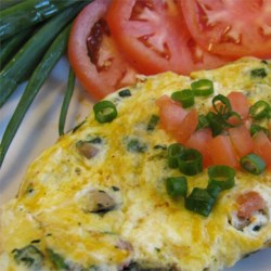 Spinach Mushroom Omelet Recipe - A hearty but healthy breakfast or brunch omelet, filled with cheese, mushrooms, spinach, and peppers. Serve with a slice of whole grain toast and fruit.