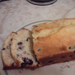 Blueberry Lemon Bread Recipe - This fresh blueberry quick bread is made with butter and flavored with grated lemon zest.