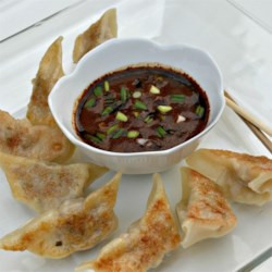 Dumpling Dipping Sauce Recipe - This dipping sauce with two kinds of soy sauce, chili oil, garlic, and ginger is great for dipping Asian-style finger foods like egg rolls and pot stickers.