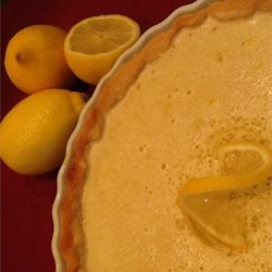 The Best Lemon Tart Ever Recipe - Rich lemon filling makes up the center of a decadent tart with a golden-brown shortbread crust.