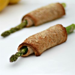 Asparagus Roll-Ups Recipe - Multi-grain bread rolled around asparagus, cream cheese, and bacon make for tasty appetizers you can eat without utensils.