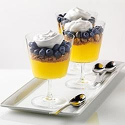 Blueberry-Lemon Parfaits Recipe - Layers of lemon pie filling and a crumbled graham/almond mixture are topped with fresh blueberries and a dollop of meringue.