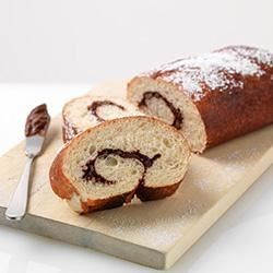 Choco-Cherry Bread Recipe - Dried cherries and chopped pecans with a swirl of chocolate make this bread a delicious snack or breakfast treat, especially when spread with chocolate butter.