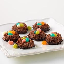 Chocolate Macaroon Nests Recipe - Chocolate and coconut 'nests' are filled with pastel-colored candies in these sweet, springtime treats.