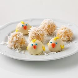 Hawaiian Cookie Balls Recipe - Cookie balls made with crushed cookies, instant pudding, and pineapple are rolled in coconut or dipped in white chocolate for a little taste of the islands.