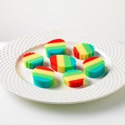 Rainbow JIGGELRS Recipe - These bright multi-colored JELL-O treats will bring smiles to snackers of all ages.