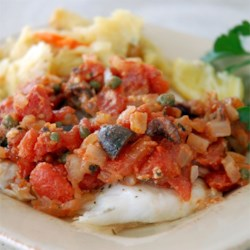 Flounder Mediterranean Recipe and Video - Flounder is baked in a Parmesan tomato sauce made with Italian herbs and seasonings, olives, and white wine.