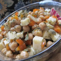 Chickpea and Cheese Salad Recipe - Havarti cheese and canned garbanzo beans are dressed in a quick and easy vinaigrette and tossed with green onions, chives, and dill in this tasty salad recipe.
