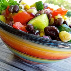 Black Bean and Cucumber Salad Recipe - Black beans add protein to this cucumber salad seasoned with orange marmalade, honey, cumin, and lemon juice.