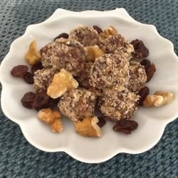 Raw Candy Recipe - Raisins and walnuts are blended and rolled in sliced almonds for sweet treats you'll feel good about eating.