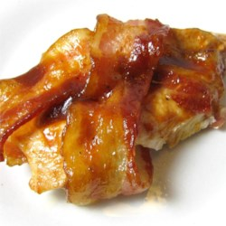 Barbeque Bacon Chicken Bake Recipe - Those same old chicken breasts get a hearty, smoky flavor when wrapped in bacon and baked with barbeque sauce in a simple recipe. You can make them on the grill, too.