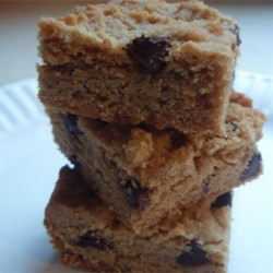 Easy Peanut Butter Bars Recipe - Crowd-pleasing peanut butter bars are ready in less than an hour and will disappear from the table in minutes.