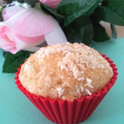 Coconut Mango Muffins with Candied Ginger Recipe - An exotic combination of dried mango and candied ginger flavors this delicious muffin. The coconut sprinkled on top gives an extra crunch and a lovely appearance.