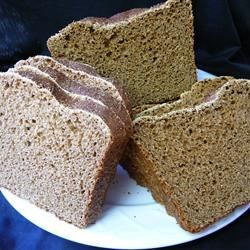 Pumpernickel Bread I Recipe - This is a bread machine product that is dark in color, but lighter in texture.  Molasses and cocoa account for the deep color, bread flour and cornmeal ensure the lighter quality.