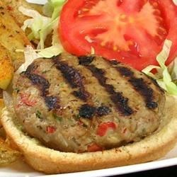 Fiesta Stuffed Turkey Burgers Recipe - These turkey burgers are elevated by a pepperjack cheese center surrounded by a mixture of ground turkey, minced vegetables, herbs, and seasonings.