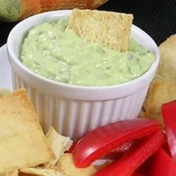 Avocado Tzatziki Recipe - A colorful California version of this classic Greek sauce. Use on your favorite pita sandwich, gyro, falafel or as a fresh veggie dip. Also try it as a condiment for spicy Indian food and curries. Make it using yogurt in place of sour cream, or even without the sour cream for a great vegan alternative!
