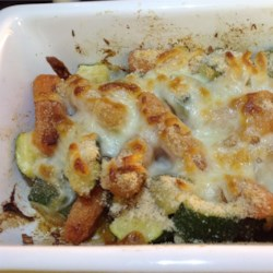Carrot and Zucchini Casserole Recipe - Carrots and zucchini are baked in a rich and cheesy casserole and topped with a crunchy bread crumb layer.
