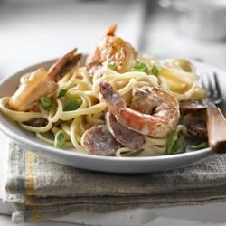 Cajun Poached Shrimp Linguine Recipe - Spicy Cajun flavours kick up this easy sauce, and cream adds smoothness to the heat of the dish. Look for smoked sausages where they sell bacon and other deli meats in the grocery store.