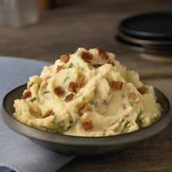 Swanson(R) Ultimate Mashed Potatoes Recipe - Potatoes get even better when they're cooked in Swanson(R) Chicken Broth, then mashed until smooth with just the right amount of light cream, sour cream, chives, butter, bacon and black pepper.