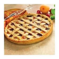 Linzer Torte Recipe - This is a beautiful and tasty tart-like dessert, made by layering fruit preserves on a crumbly almond and lemon butter crust.