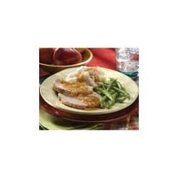 Roast Pork with Apple and Onion Gravy Recipe - Apple and onion season a golden pork gravy for saucing a tender pork roast.