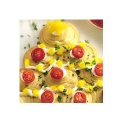 Holiday Herb Crescent Trees Recipe - A holiday-shaped tree decorated with cherry tomatoes and yellow peppers.