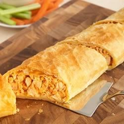 Buffalo Chicken Stromboli Recipe - Sure to be the hit of any gathering, this delectable Stromboli has a light and flaky puff pastry crust filled with the wonderful flavors of buffalo chicken.  It's a keeper!