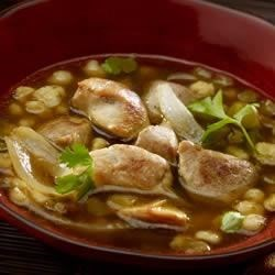 Green Pozole Recipe - This version of the traditional Mexican pork stew is made in a slow cooker with prepared chicken broth, salsa, canned green chilies, and, of course, hominy.