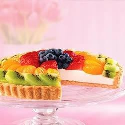 Fresh Fruit Tart with Ginger Snap Crust Recipe - This entrancing fruit topped tart has a home made ginger snap crust and a creamy filling underneath a glorious pile of fresh fruit.