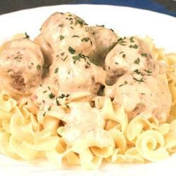 Swedish Meatballs I Recipe - Meatballs  of ground beef mixed with onion and dry cream of wheat are baked for 20 minutes, combined in a casserole with condensed cream soups and evaporated milk, and baked another 40 minutes.