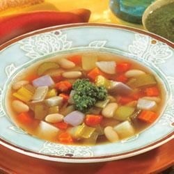 Swanson(R) Winter Vegetable Bean Soup with Pesto Recipe - This classic soup combines carrots, potatoes, turnips, leeks and celery in savory Swanson(R) Chicken Broth with hearty white beans and a flavorful basil pesto garnish.