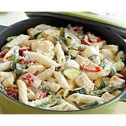 PHILADELPHIA Creamy Pasta Primavera Recipe - Chicken breast, penne pasta, and garden fresh vegetables are tossed in a creamy sauce made with cream cheese.