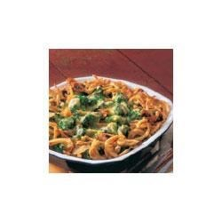 Cheddar Broccoli Bake Recipe - Cheddar cheese sauce and savory onion rings top colorful broccoli for a dish that's an instant classic.