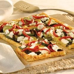 Grilled Pesto Vegetable Tart Recipe - Pepperidge Farm(R) Puff Pastry Sheets make a tender crust for this savory tart filled with layers of pesto, roasted Mediterranean vegetables, crumbled goat cheese and strips of roasted red peppers.