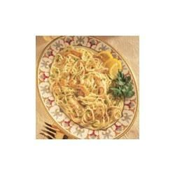 Lemony Chicken Pasta Toss Recipe - Swanson(R) Chicken Broth is the key to quick and easy cooking in this light pasta topper featuring chicken, garlic, parsley, lemon juice and a hint of Dijon-style mustard.