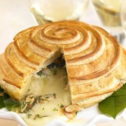 Brie en Croute Recipe - Watch this crowd-pleaser disappear at your next party: Creamy Brie topped with almonds and parsley oozes out of its flaky pastry crust. This elegant, sure-to-impress appetizer is made in minutes when you start with Pepperidge Farm(R) Puff Pastry Sheets .