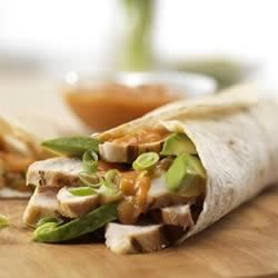 Chicken Fajitas Recipe - Marinated grilled chicken piled into warm tortillas and topped with bold cheese sauce, Pace(R) Chunky Salsa, green onions and buttery avocado. Colorful, delicious and distinctive!