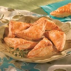 Mushroom and Bacon Triangles Recipe - These hors d'oeuvres are truly easy to make! Roll out thawed Pepperidge Farm(R) Puff Pastry Sheets and cut into squares. Fill with mushroom-cheese filling and fold into mini triangles before baking.