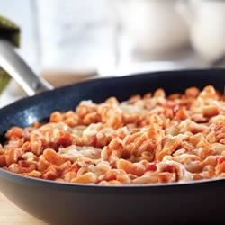 Quick Skillet Chicken and Macaroni Parmesan Recipe - This family-friendly, one-skillet dish is so easy and delicious, it's sure to become one of your 'go-to' recipes. Using canned chicken and prepared pasta sauce ensures that it's on the table in a jiffy.