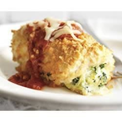 Chicken-Parmesan Bundles Recipe - A creamy, cheesy spinach blend is rolled into flattened chicken breasts that are baked and served with pasta sauce and shredded mozzarella cheese.