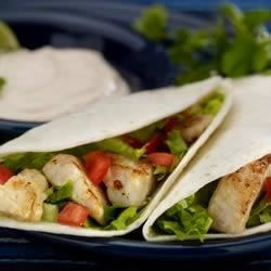 DONA MARIA(R) Fish Tacos Recipe - Fish fillets seasoned with chicken bouillon, cumin, and garlic powder make terrific tacos topped with a citrus-accented lettuce mixture and prepared salsa.