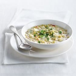 Corn and Red Pepper Chowder Recipe - Capture the harvest with fresh vegetables in this hearty yet fresh-tasting chowder. Real cream gives you that real chowder experience. Crusty multi-grain bread with a slice of Canadian cheese on the side makes a great meal.