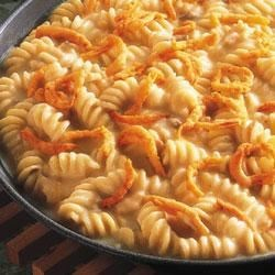 Three-Cheese Pasta Skillet Recipe - The satisfying crunch of crispy onions tops this simple and cheesy one-pan pasta dish that pairs well with meat loaf or roast chicken.